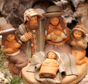 Holy Family in Bolivia with two angels in terracotta Nativity scene at Christmas